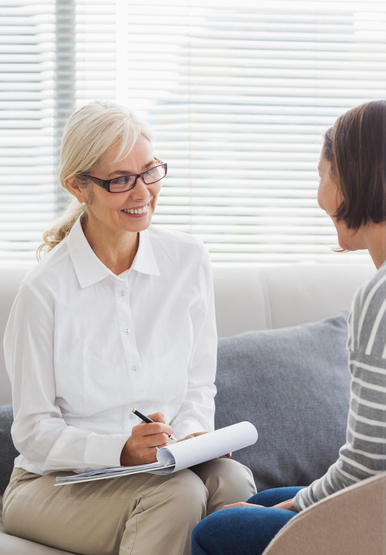 smiling therapist talking to her female client