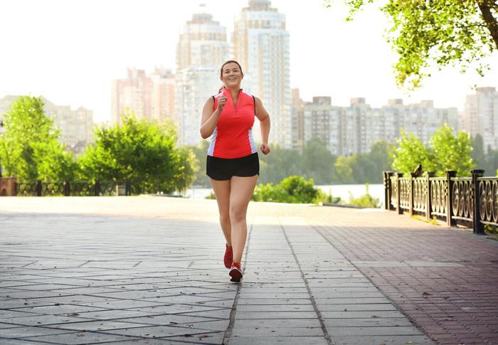 woman power walking on street - exercise
