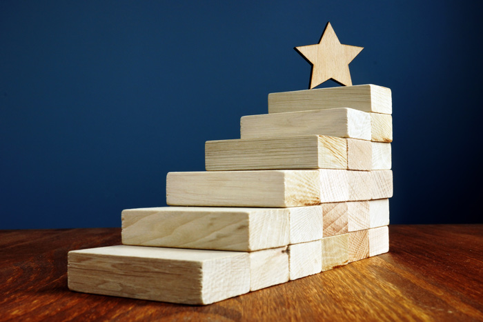 wooden blocks stair-stepped with star at top of stairs - goals
