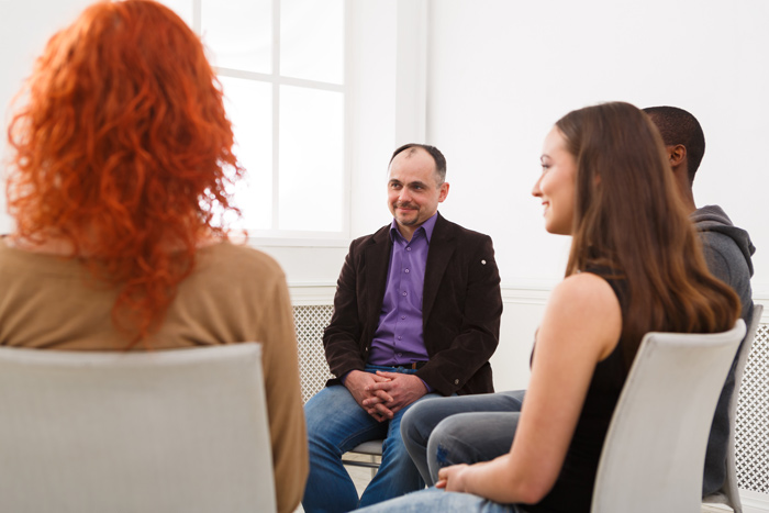group therapy session with diverse clients